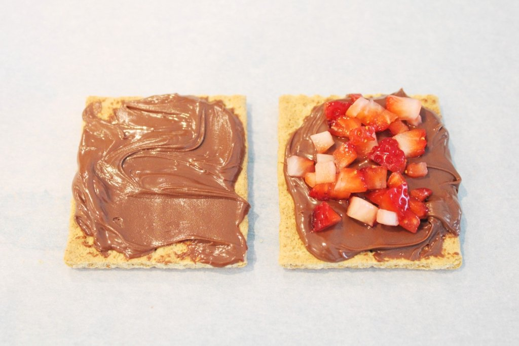 Spreading Nutella and Strawberries