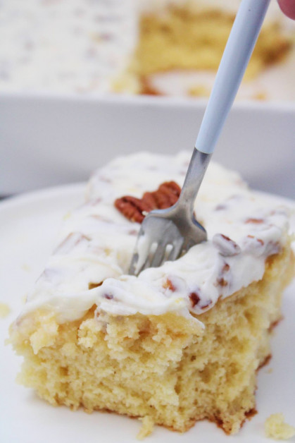 A slice of Elvis Presley Cake with pineapples and pecans