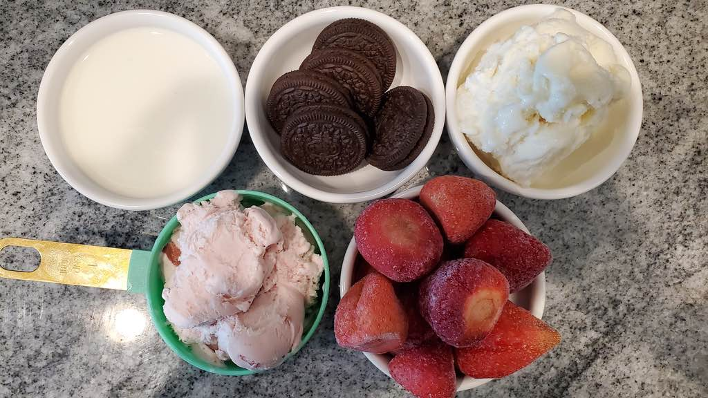 Oreo cookies, frozen strawberries, milk and ice cream
