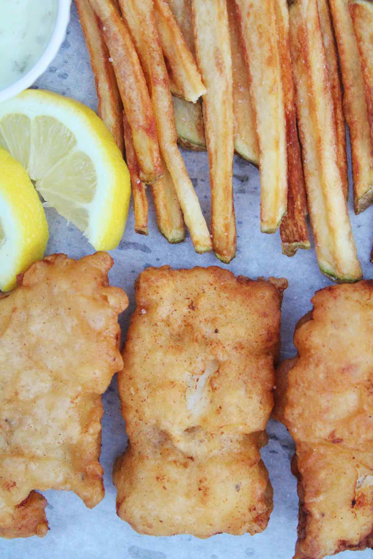 Serving beer battered cod fish and chips.