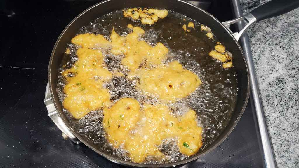 This is how you fry the fritters inside of the hot oil.