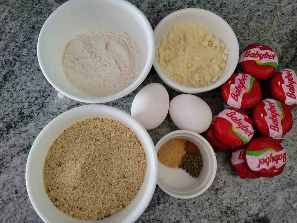 The ingredients you will need are babybel cheese, Italian bread crumbs, flour, eggs, parmesan cheese, granulated garlic, parsley flakes, salt and cayenne pepper.