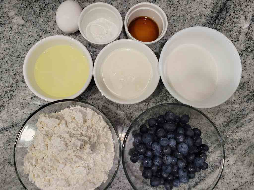The ingredients needed for this recipe are blueberries, flour, baking powder, salt, vanilla extract, buttermilk, egg, oil and sugar.