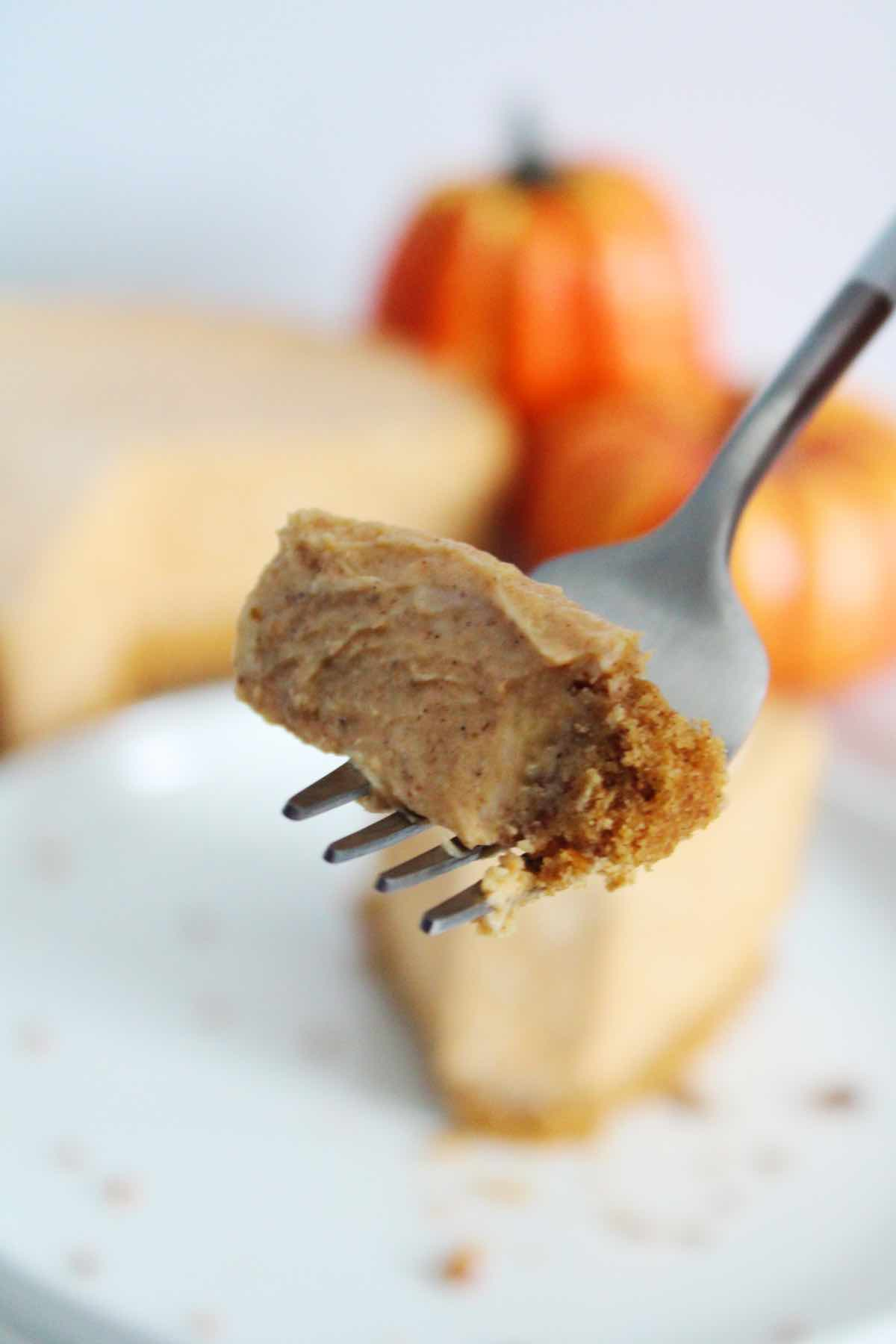 Serve this pumpkin spice cheesecake with whipped cream and chopped pecans.
