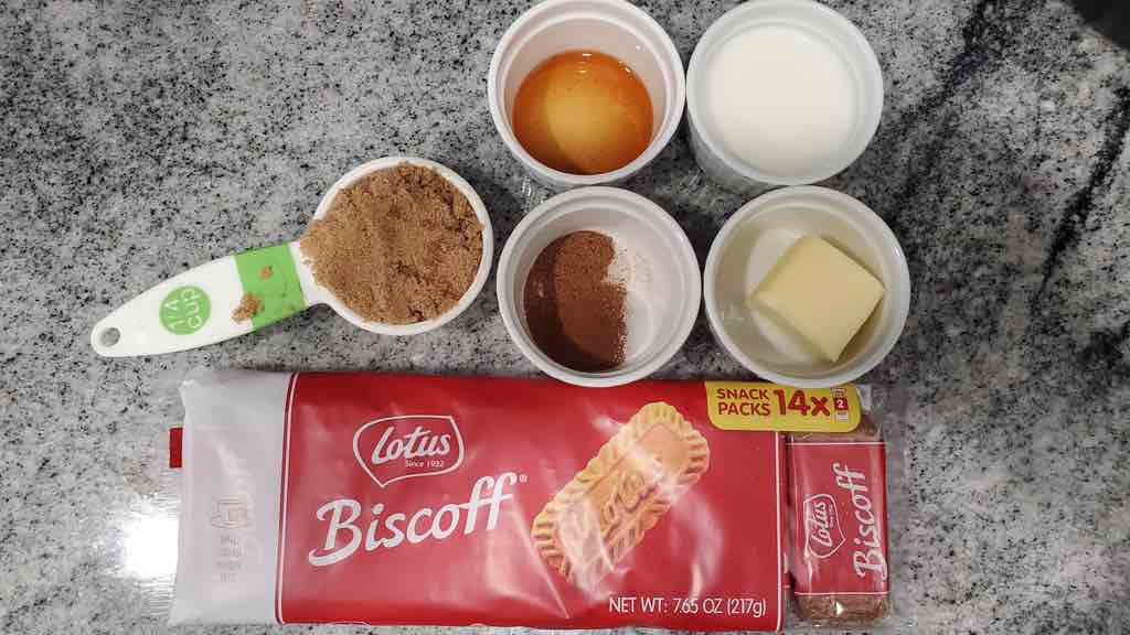 The ingredients needed to make homemade cookie butter are lotus biscoff cookies, brown sugar, vanilla extract, milk, butter, nutmeg, cinnamon and salt.