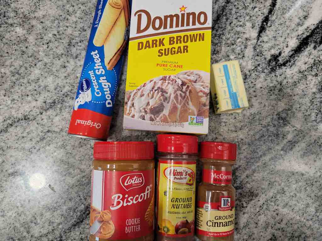 The ingredients you'll need for this recipe are cookie butter, cinnamon, brown sugar, butter, nutmeg and crescent roll dough sheets.