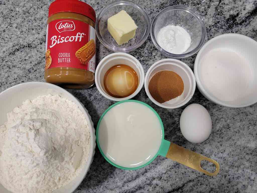 The ingredients needed for this recipe are Lotus Biscoff cookie butter, butter, vanilla extract, buttermilk, salt, baking powder, flour, cinnamon, sugar and egg.