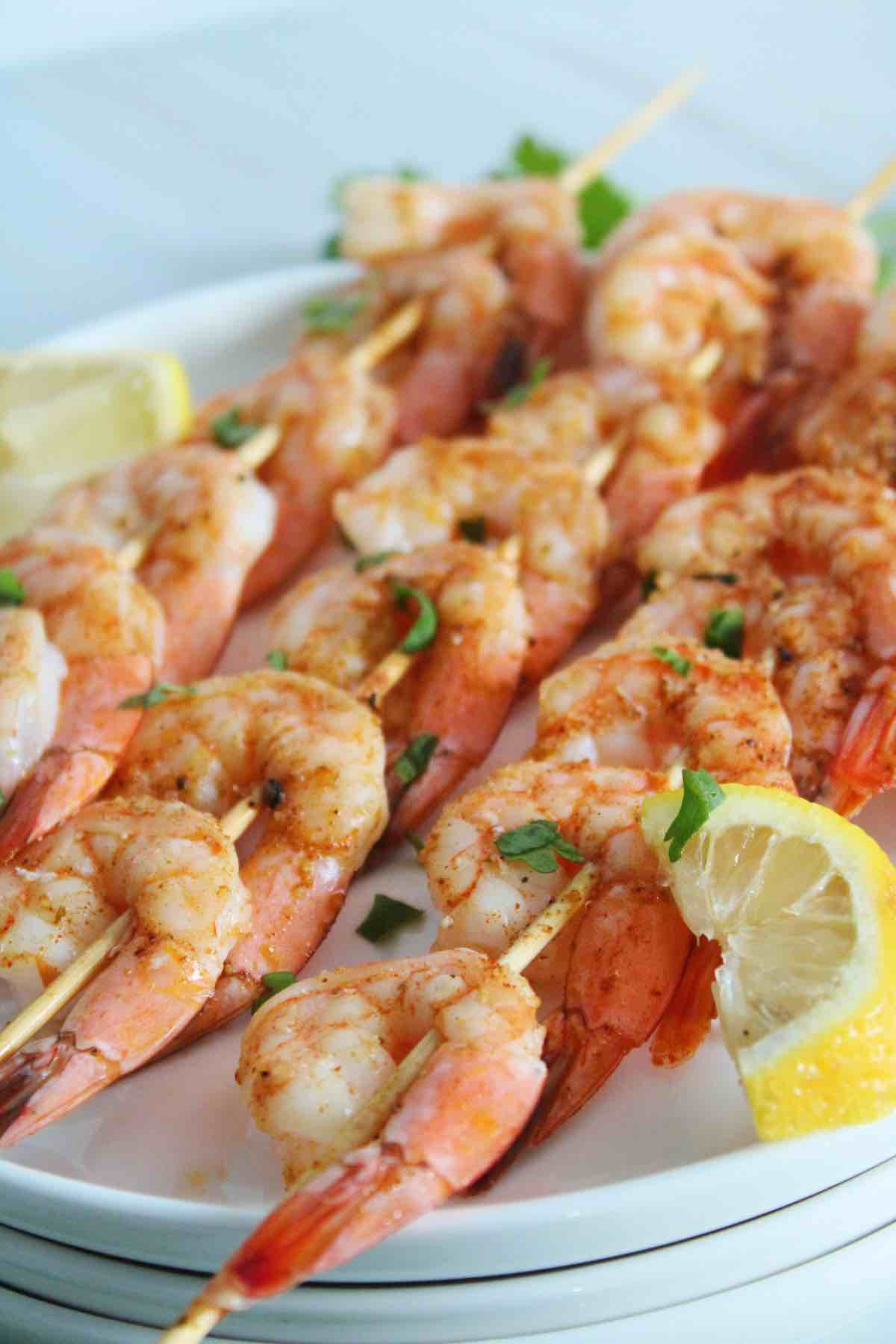 Juicy shrimp skewers are marinated then grilled.