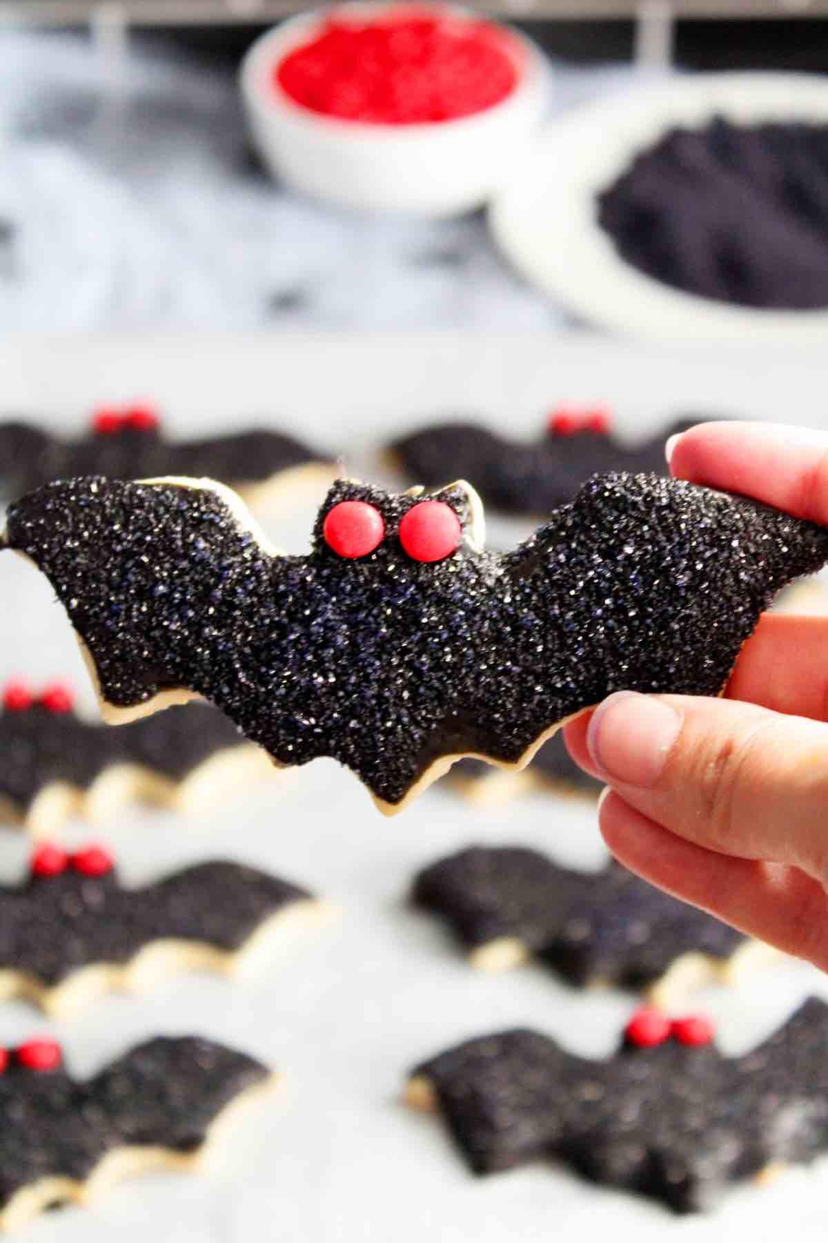 Cut out sugar cookies shaped like bats.