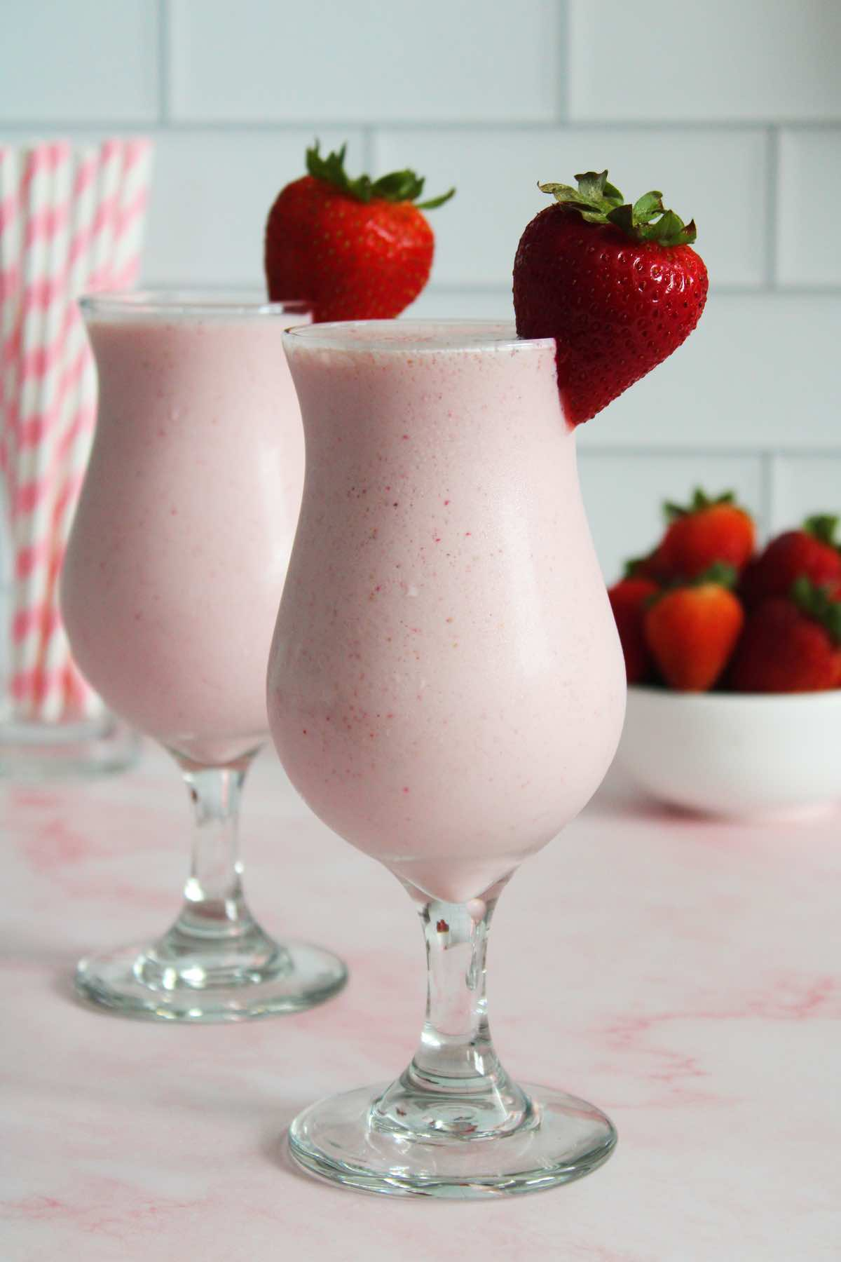 Make this easy shake with frozen strawberries, ice cream and milk.