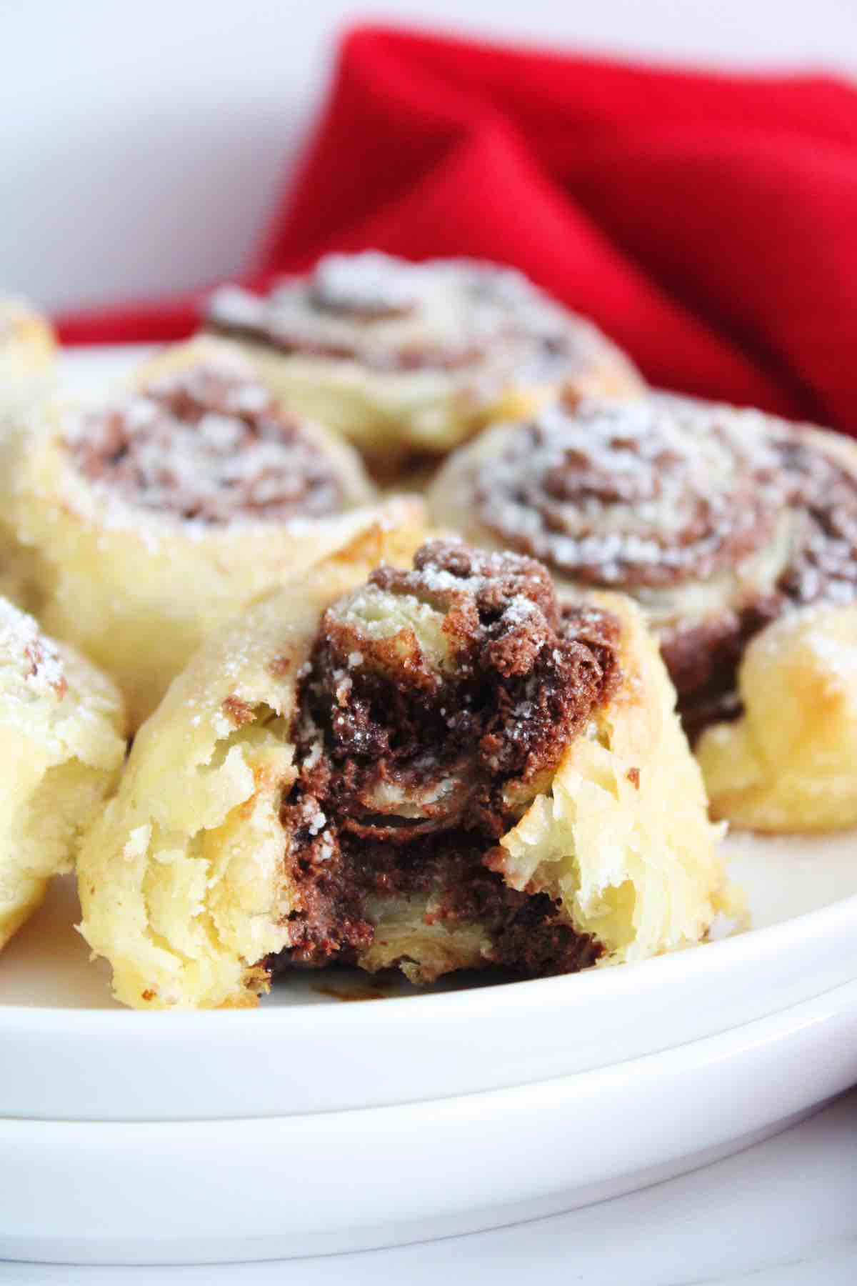 Serve these delicious nutella pastry swirls topped with powdered sugar.
