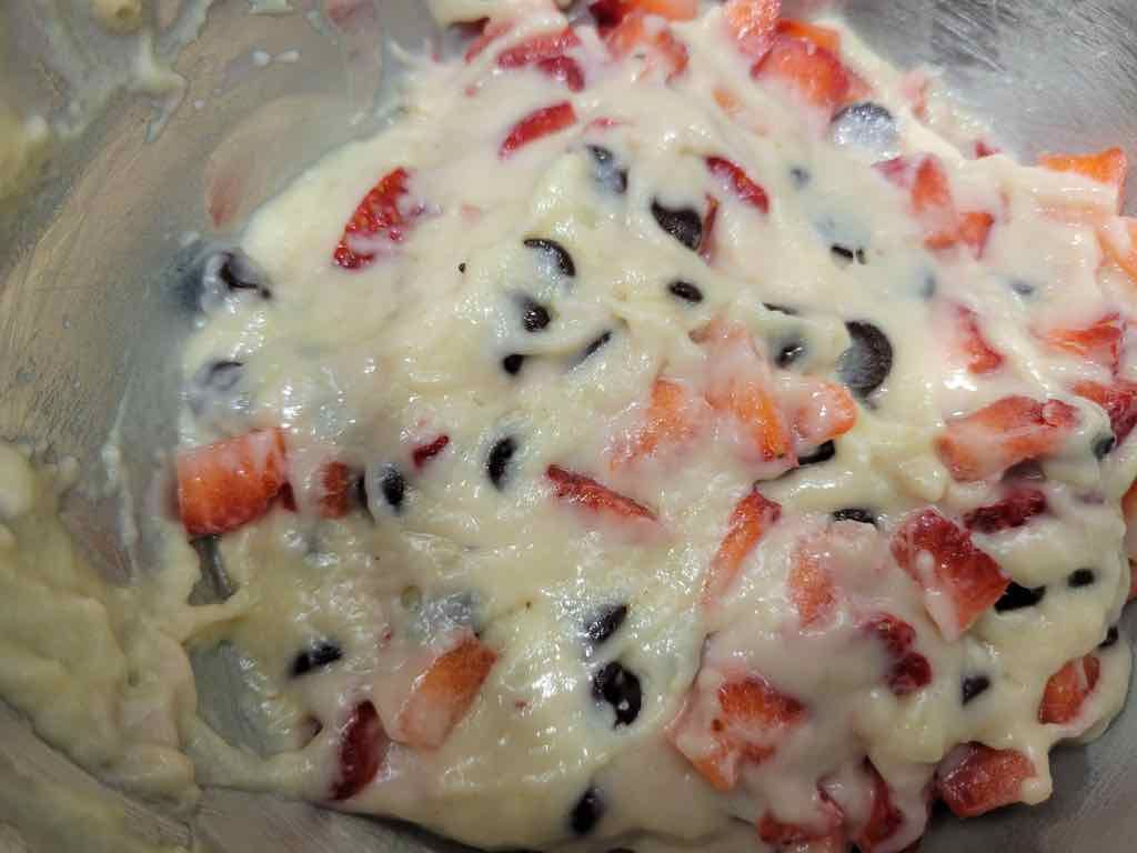 The ingredients needed for this recipe are flour, baking powder, salt, sugar, buttermilk, egg, oil, vanilla extract, chocolate chips and strawberries.