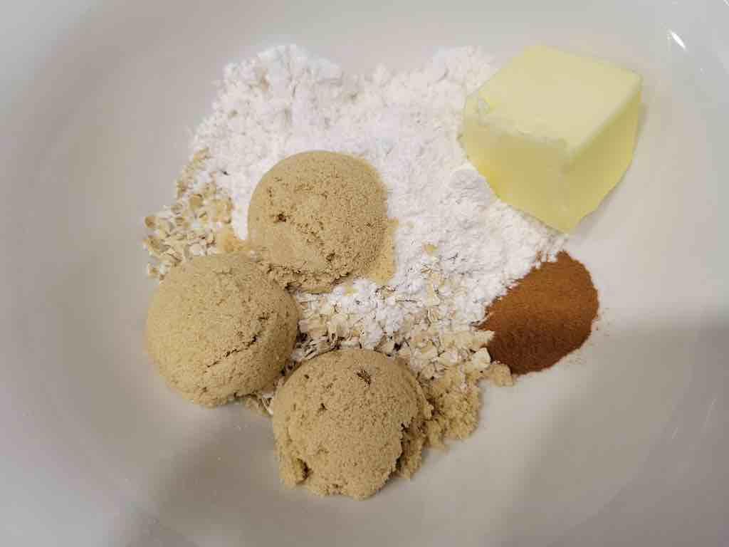 The ingredients needed are canned apple pie filling, apple pie spice, butter, flour, oats, salt, cinnamon and brown sugar.