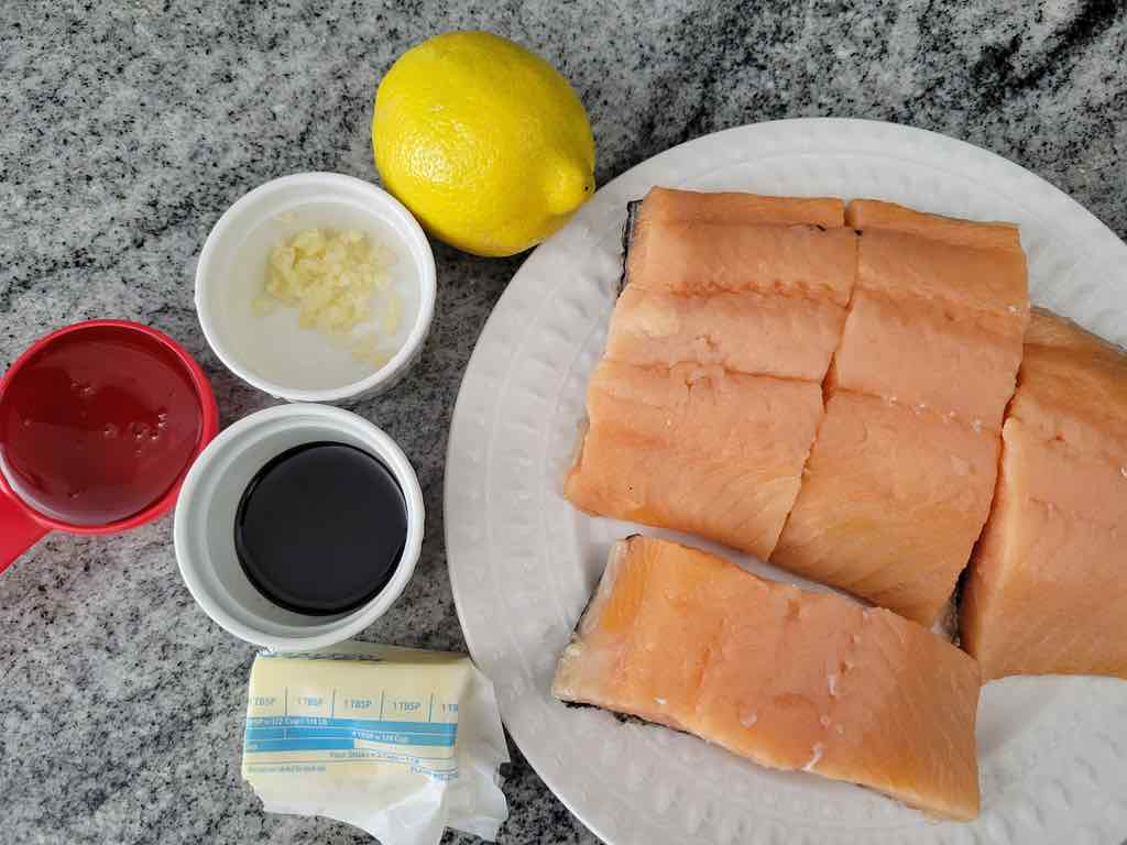 The ingredients needed are salmon fillets, soy sauce, lemon juice, honey, garlic, butter, salt and pepper.